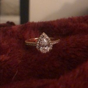 A rose gold, pear shaped ring